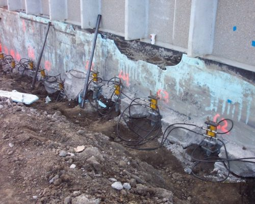 Push Piers Installed Along Foundation Wall